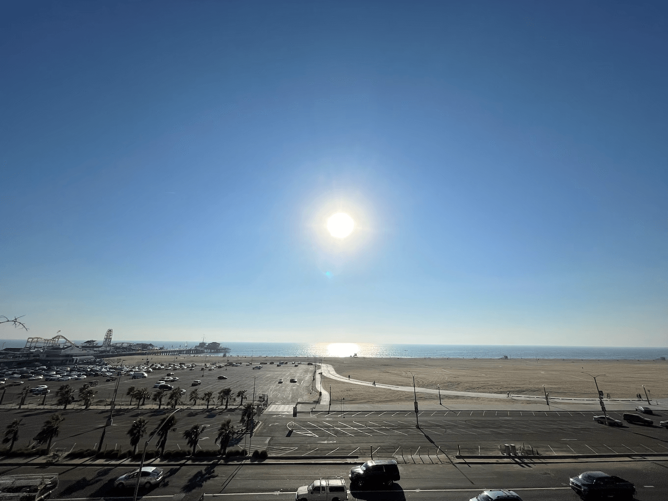 Ultra Wide shot of sun over the ocean with a lens flare.