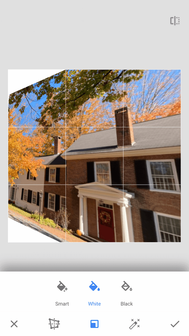 A screenshot featuring a photo of a house demonstrating how to use Snapseed's perspective tool