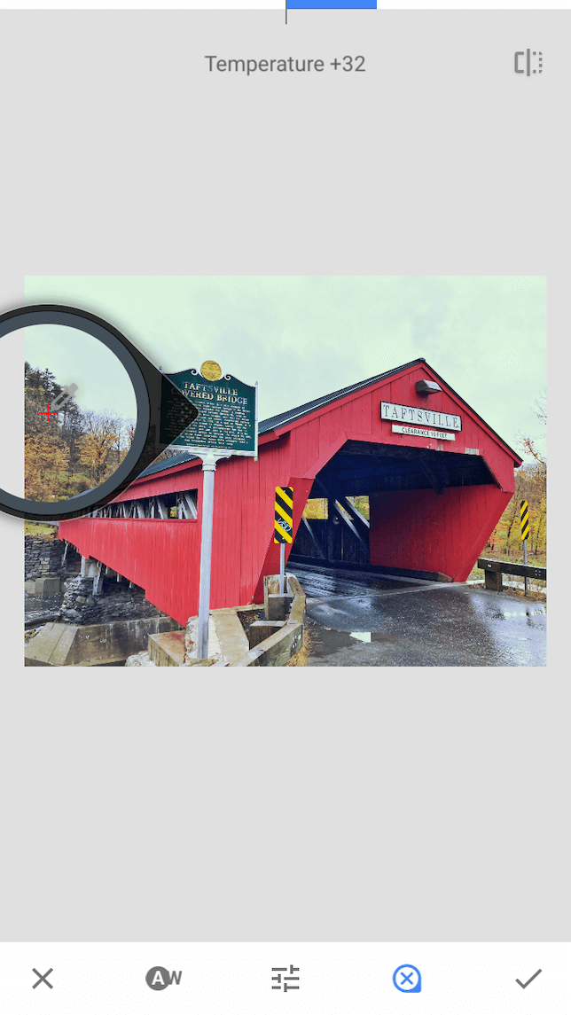 A screenshot of a covered bridge demonstrating how to use white balance in Snapseed