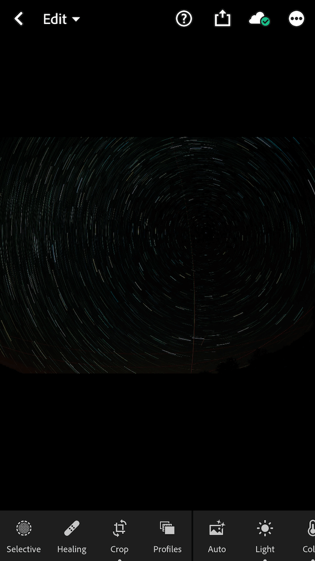 A screenshot of star trails in the Lightroom app