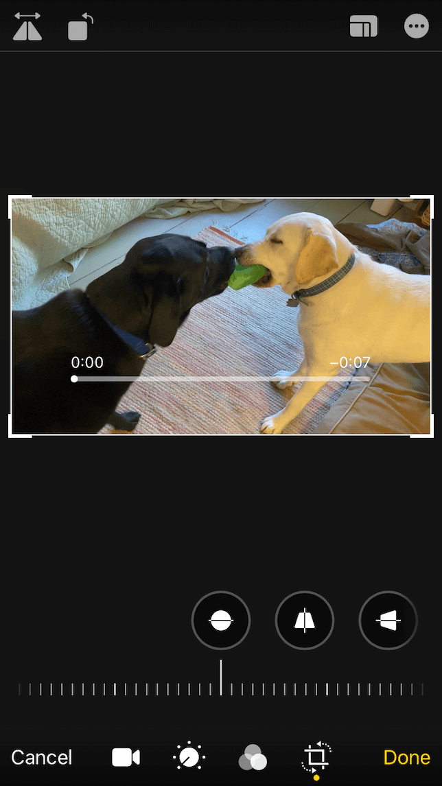 A screenshot showing how to mirror a video using the iOS Photos app