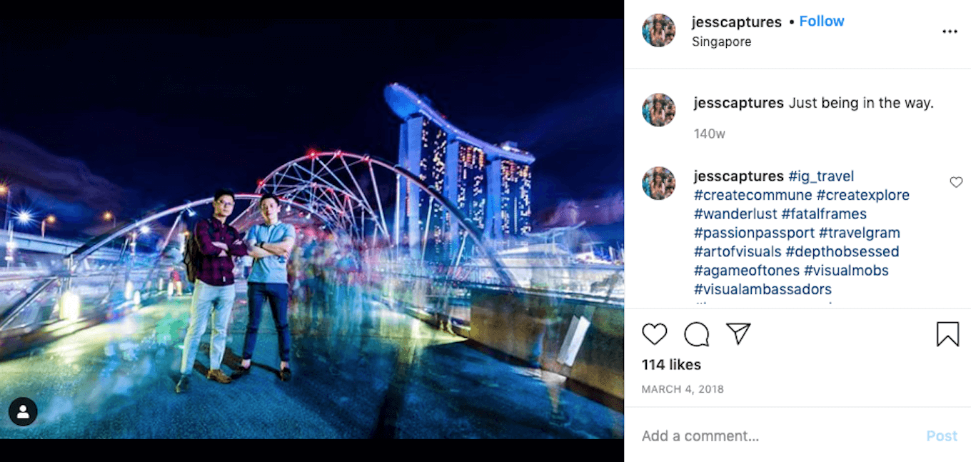 An Instagram screenshot featuring a long exposure shot of a crowd of people in front of a Singapore landmark