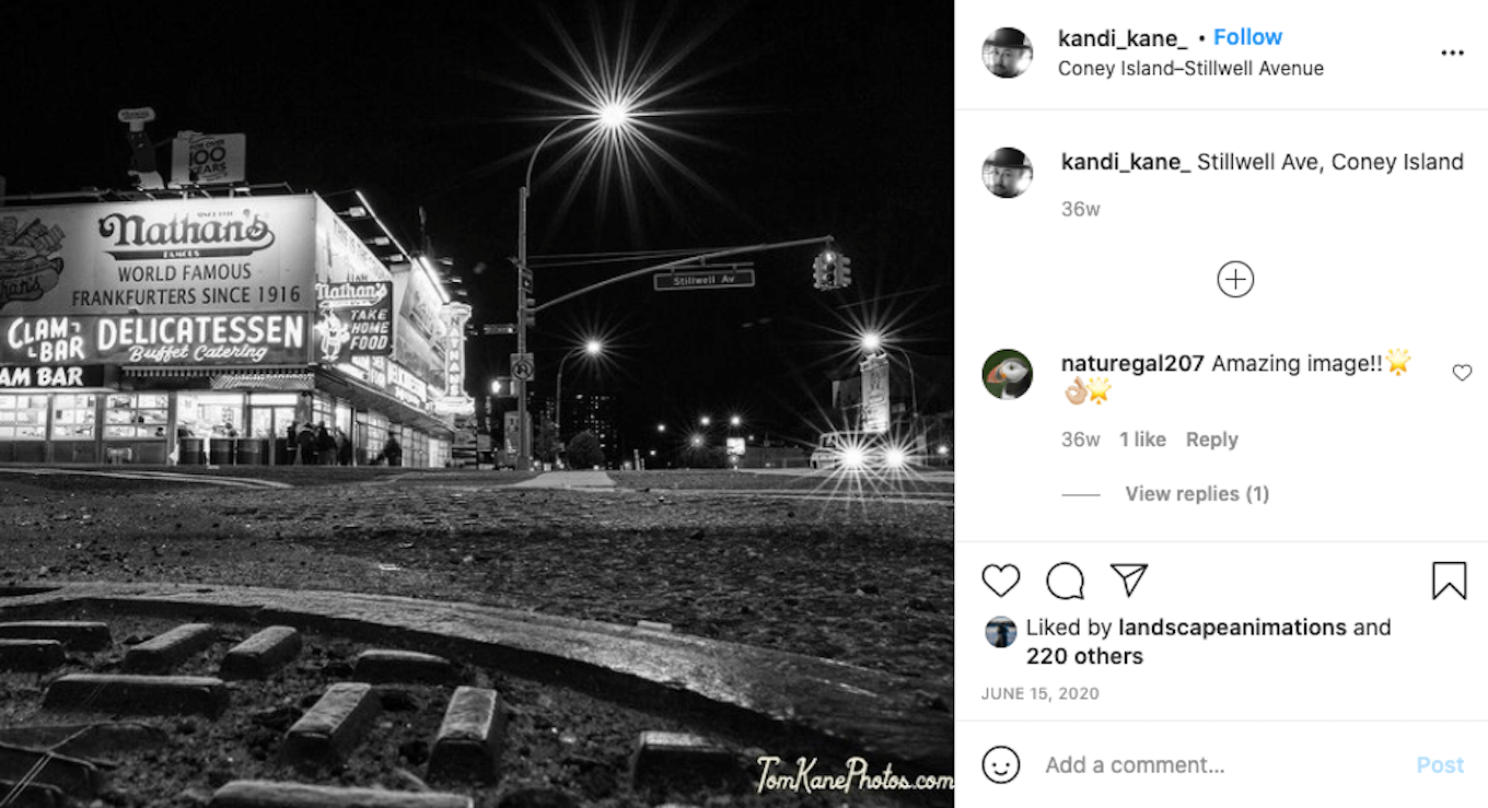 An Instagram screenshot featuring a black-and-white photo taken under artificial lights at night.