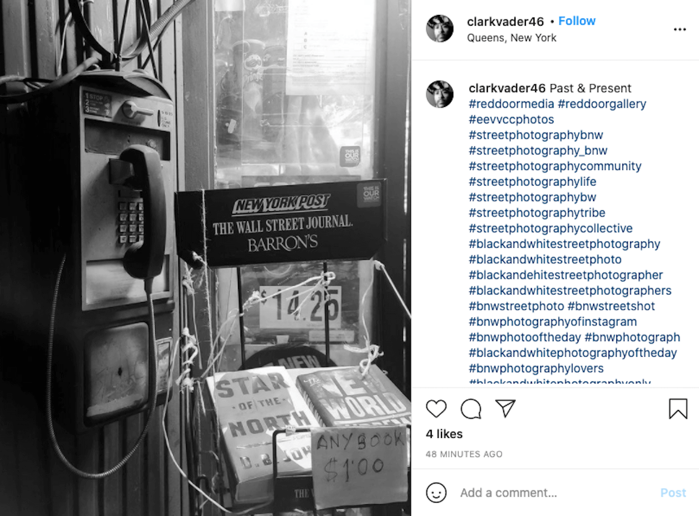 An Instagram screenshot featuring a black-and-white photo of a payphone next to books for sale.