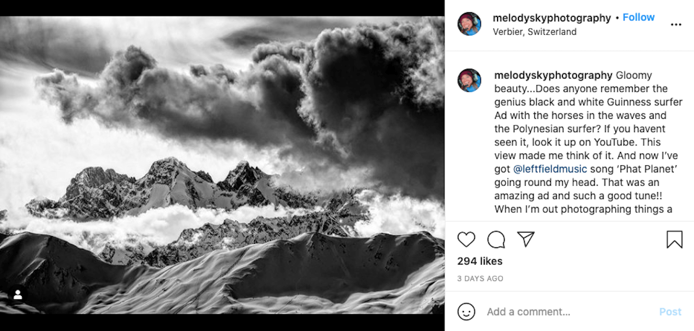 An Instagram screenshot featuring a black-and-white image of mountains with a very cloudy sky.