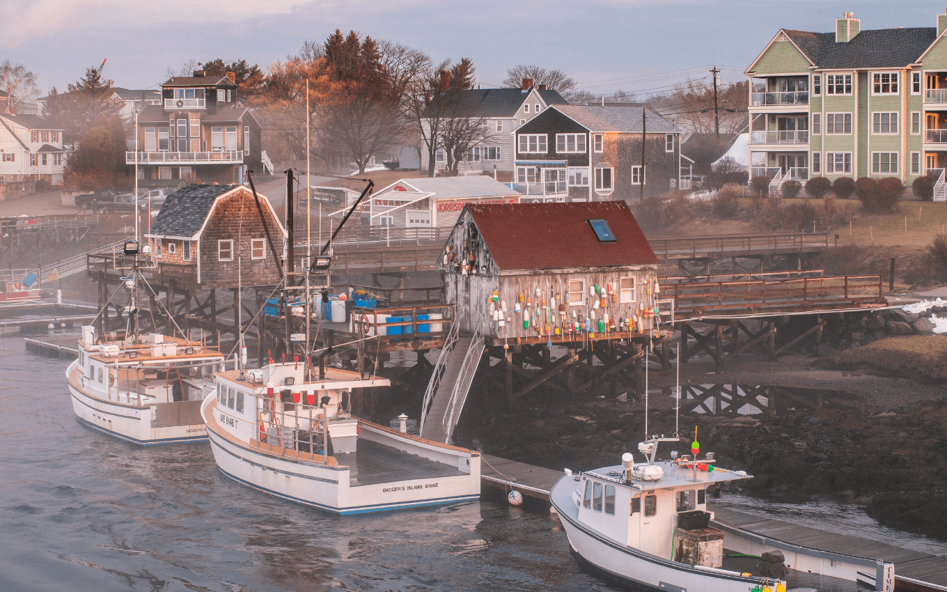 Several lobster boats moored next to a pier in New England, demonstrating the golden triangle in photography.