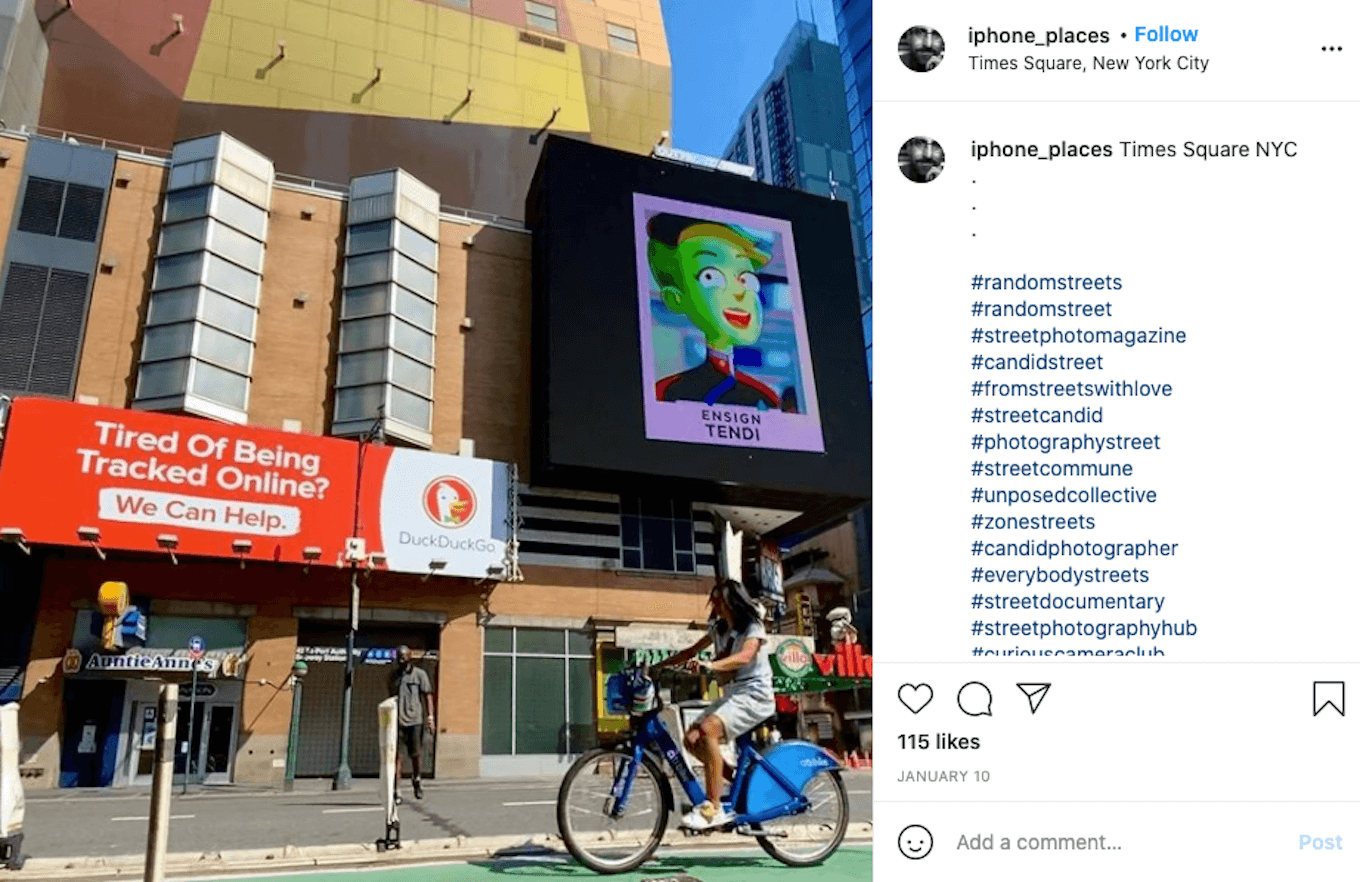 An Instagram screenshot of a woman riding a bicycle in front of several signs on a building.