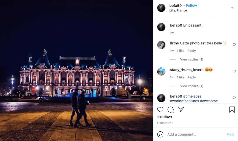 An Instagram screenshot of a couple walking through a city at night.