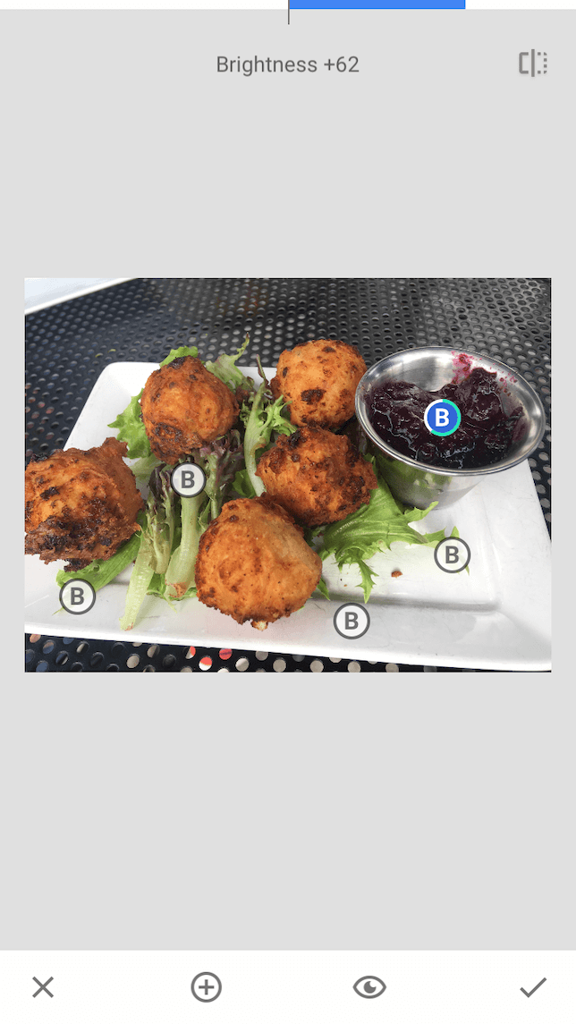 A screenshot showing how to use the selective brightness tool in Snapseed: after.