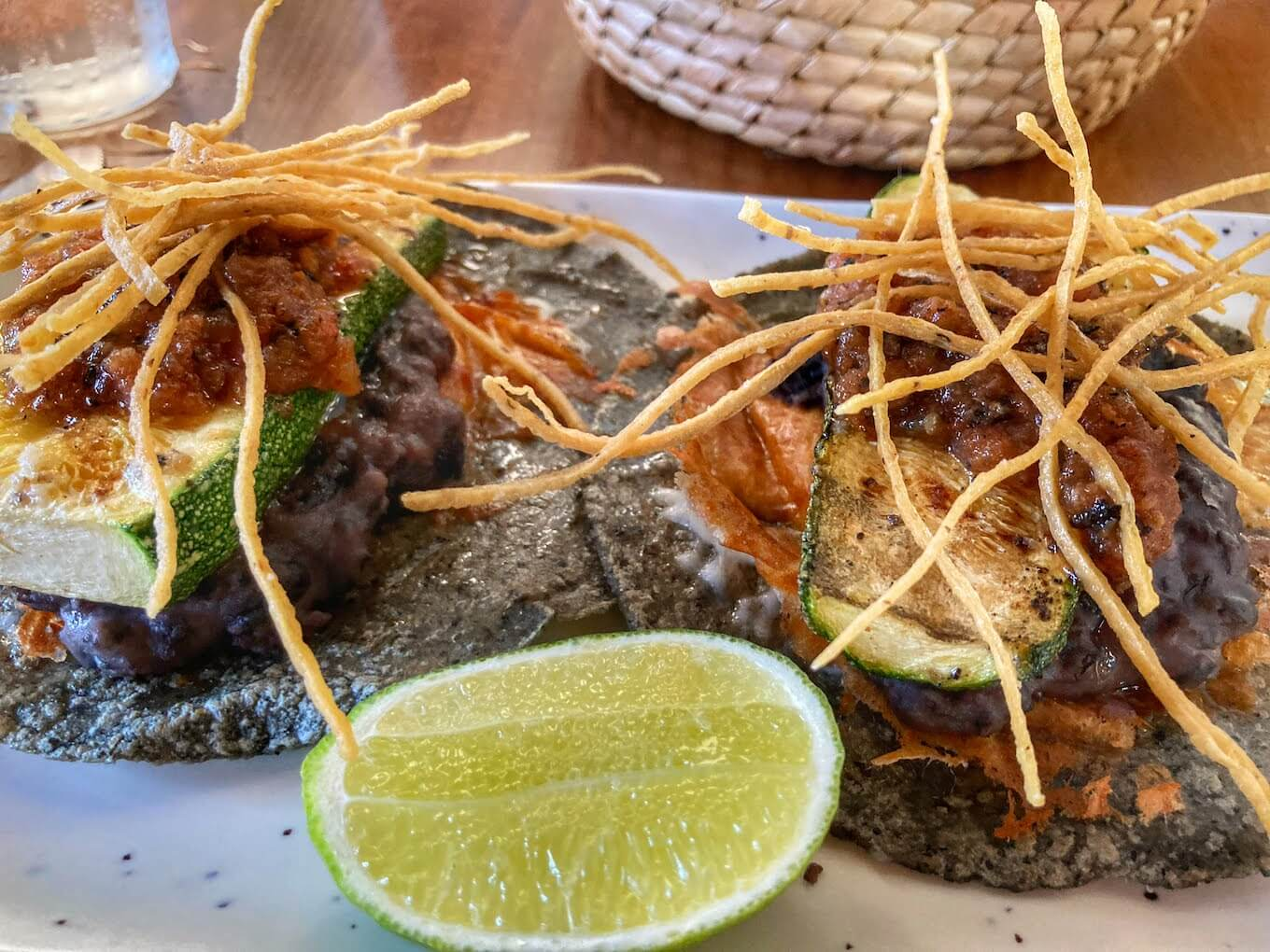 A plate of Mexican food at a restaurant. Food photography is a great example of still life photography.